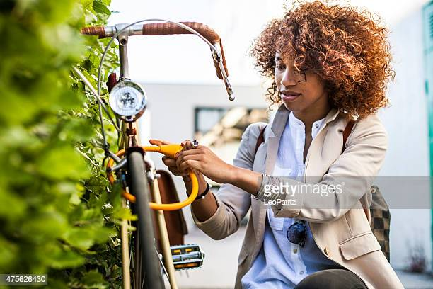 Woman locking her bicycle outside the office