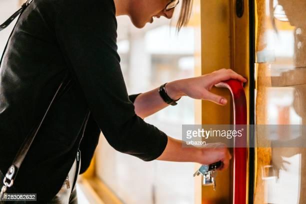 woman locking or unlocking door - unlocking stock pictures, royalty-free photos & images