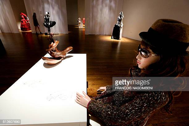 A woman lokks at an art work on February 25 2016 in Amiens northern France at the House of Culture inaugurated by French Culture minister Andre...