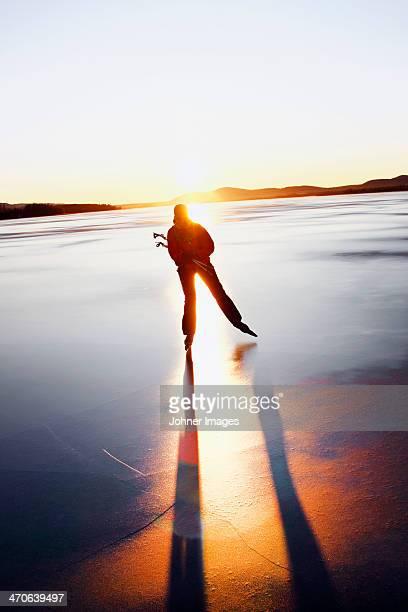 Woman long-distance skating at sunset