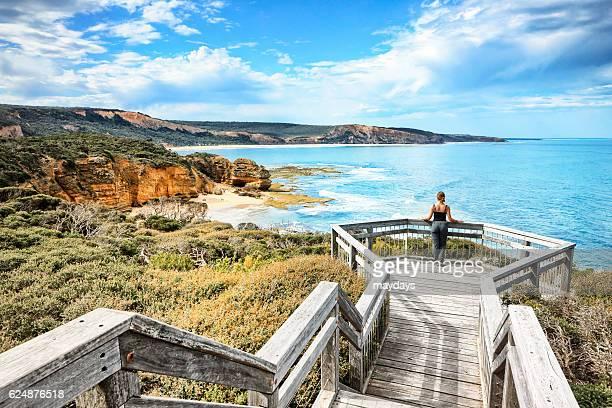 A woman look at Ocean at Bells Beach near Torquay, Victoria, Australia, South Pacific