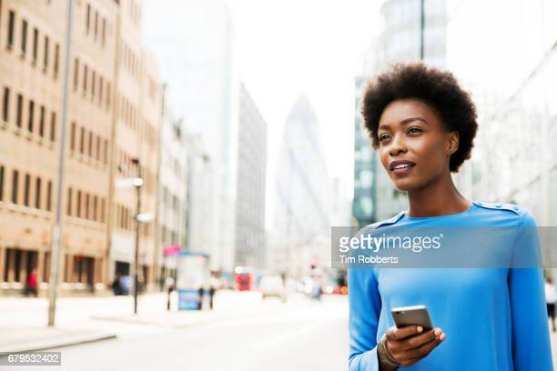 Woman looking ahead with phone
