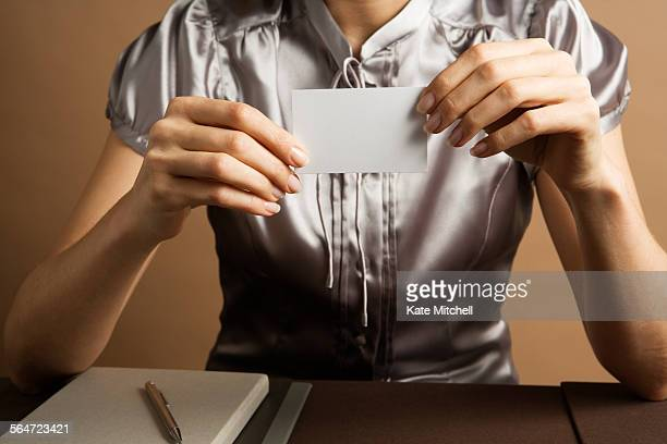 Woman Looking at a Business Card
