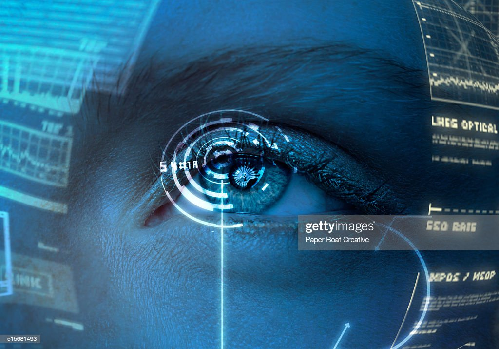 Woman looking at a hologram screen in front of her : Stock Photo