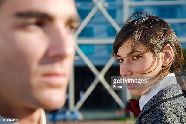 Woman looking at a man with distrust