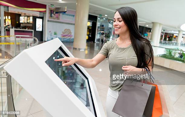 Woman looking at a map at the shopping center