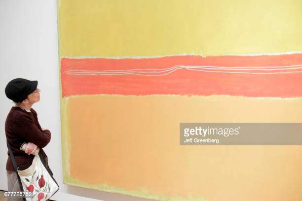 A woman looking at a painting by Mark Rothko at The Museum of Modern Art on 53rd Street Manhattan