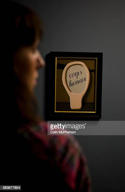 A woman looking at a painting entitled 'Magic Mirror ' by Rene Magritte An exhibition of the artist's work will open at Tate Liverpool on 24 June...