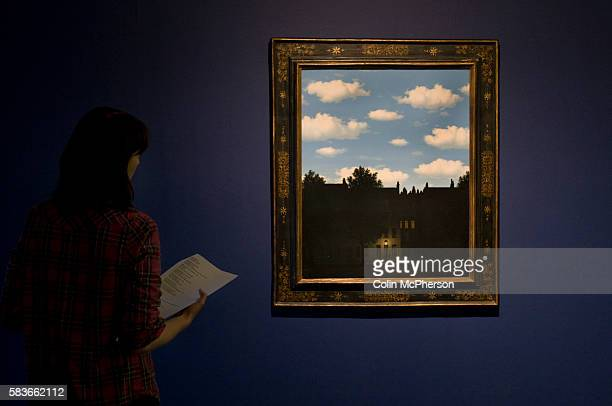 A woman looking at a painting entitled 'The Dominion of Light ' by Rene Magritte An exhibition of the artist's work will open at Tate Liverpool on 24...