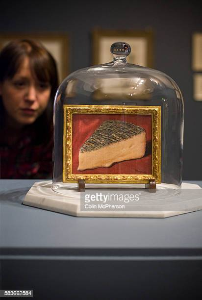 A woman looking at a painting entitled 'This Is A Piece Of Cheese ' by Rene Magritte An exhibition of the artist's work will open at Tate Liverpool...