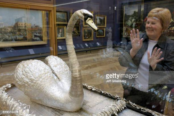 A woman looking at a Silver Swan automaton inside The Bowes Museum at Barnard Castle