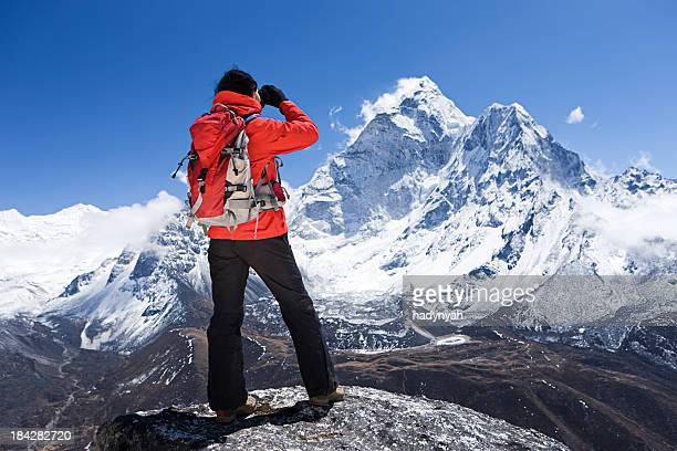 woman looking at ama dablam, mount everest national park, nepal - mt. everest stock pictures, royalty-free photos & images