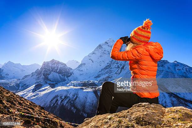 Woman looking at Ama Dablam, Mount Everest National Park, Nepal