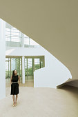 Woman looking at architecture in lobby of building