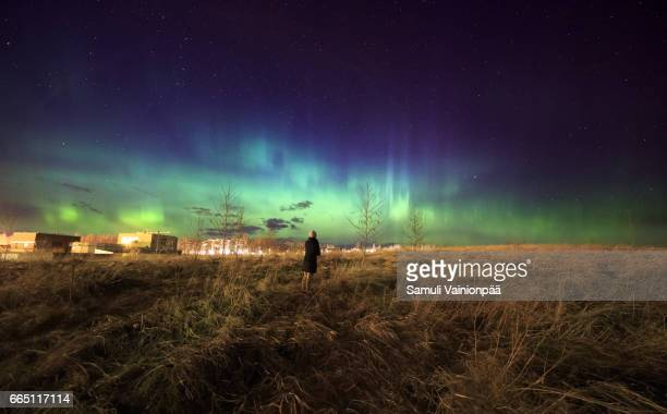 Woman looking at Aurora Borealis in Tampere, Finland