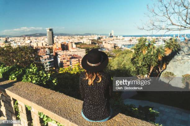 Woman looking at Barcelona cityscape