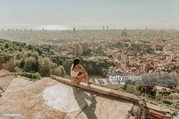 woman looking at barcelona - barcelona spain stock pictures, royalty-free photos & images