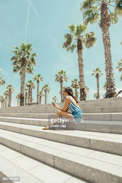 woman looking at barceloneta beach - la barceloneta stock pictures, royalty-free photos & images