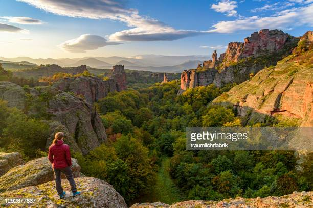 woman looking at belogradchik rocks at sunrise - bulgaria stock pictures, royalty-free photos & images