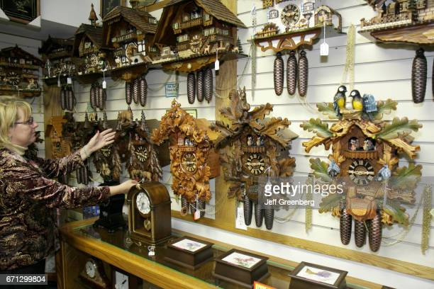 A woman looking at Black Forest cuckoo clocks at Frankenmuth Clock Company
