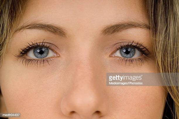 woman looking at camera, close up - nariz humano imagens e fotografias de stock