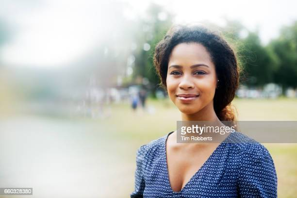 Woman looking at camera in park