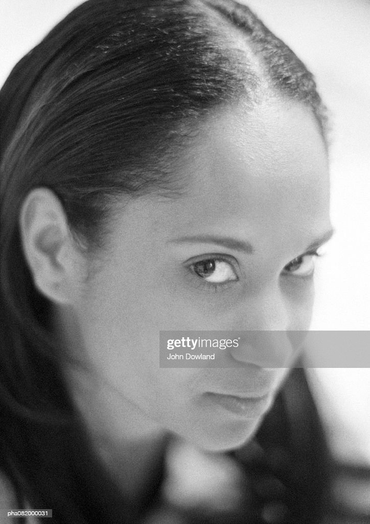 Woman looking at camera, portrait, B&W. : Stockfoto