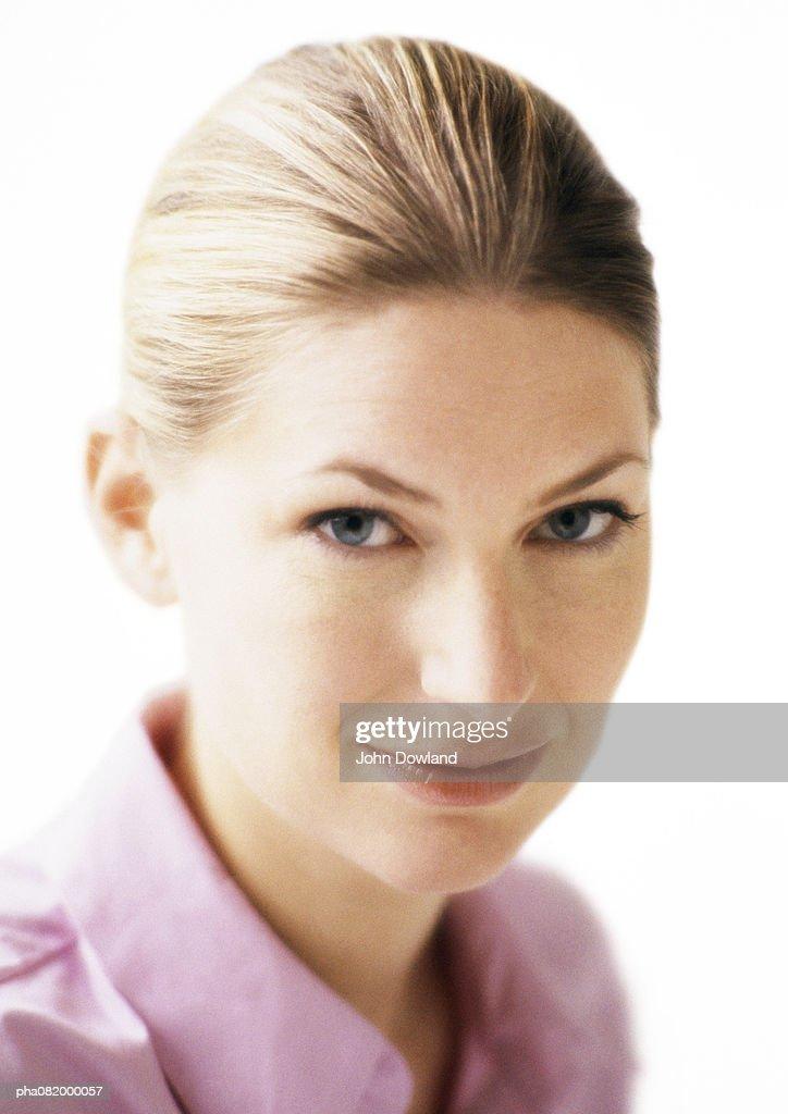 Woman looking at camera, portrait. : Stockfoto