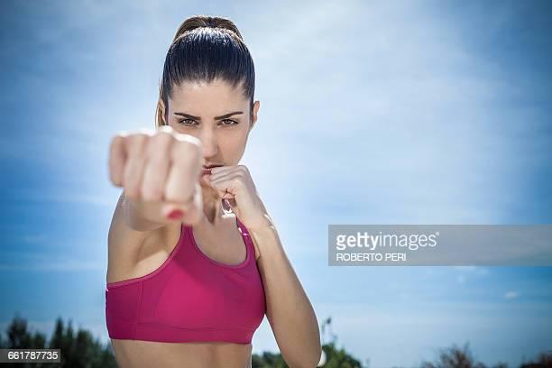 Woman looking at camera shadowboxing