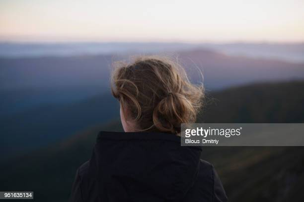 Woman looking at Carpathian mountain view, Ukraine