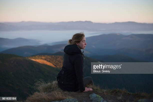 Woman looking at Carpathian mountain view, Ukraine