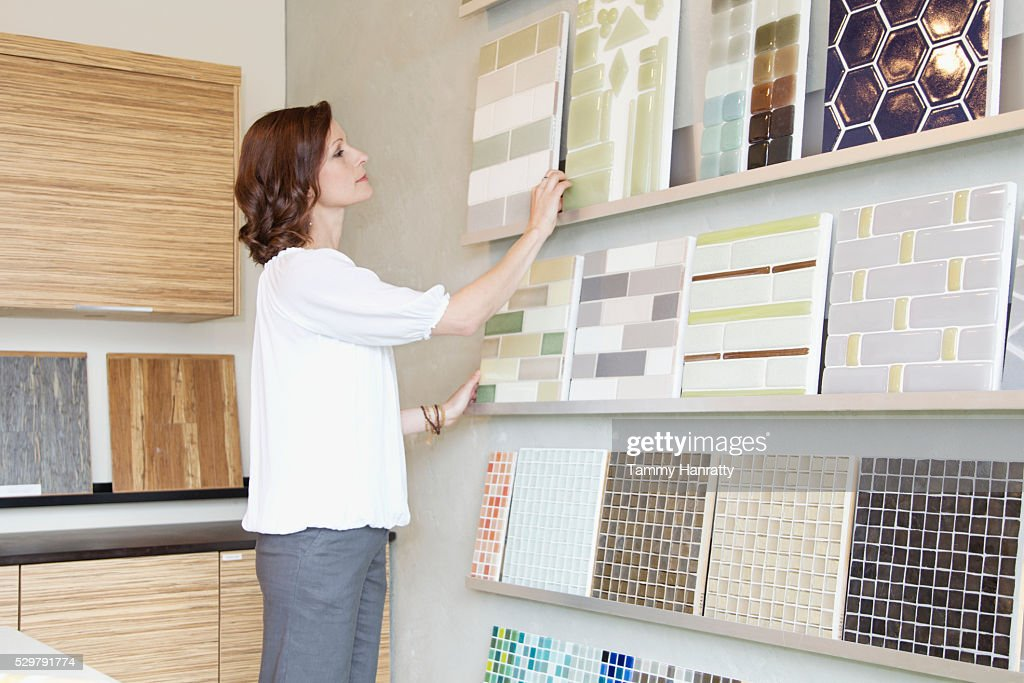 Woman looking at color swatches : Stock Photo