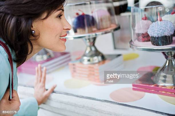 Woman Looking at Cupcakes in Window
