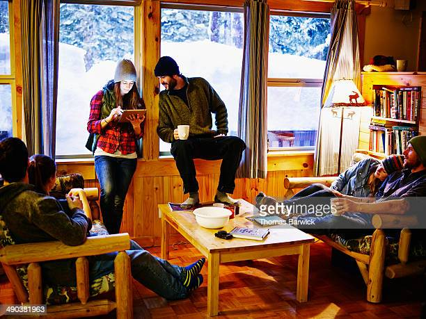 Woman looking at digital tablet with boyfriend