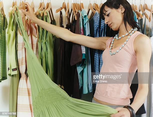 Woman Looking at Dress in Boutique