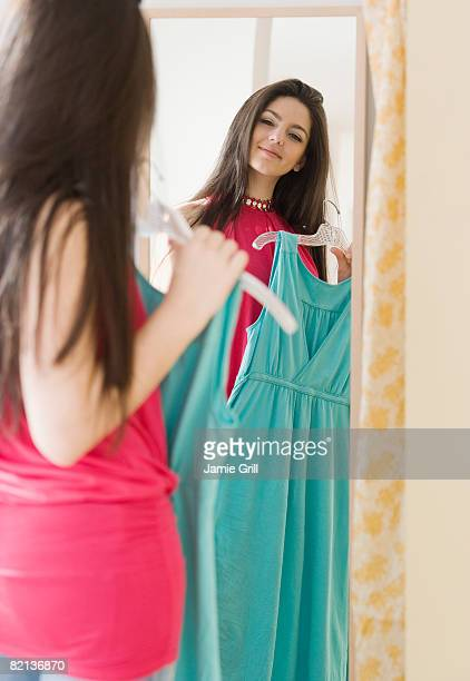 Woman looking at dress in mirror