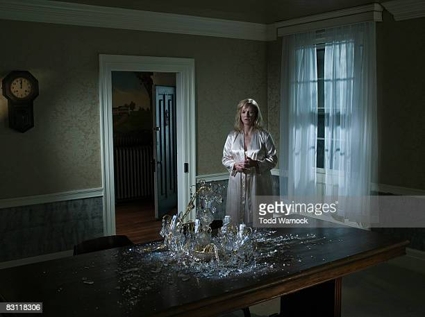 woman looking at fallen chandelier