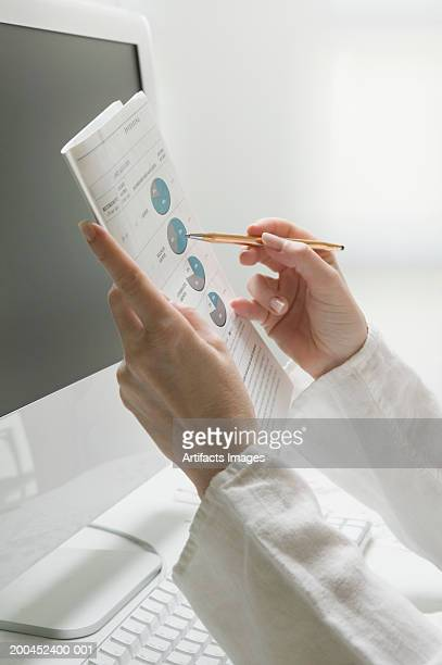 Woman looking at financial options, side view, close-up
