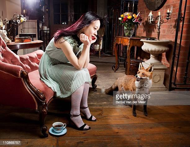 Woman looking at fox.