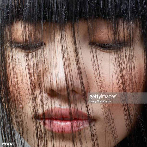 Woman looking at hair combed over face