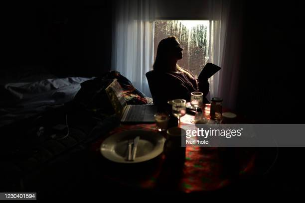 Woman looking at her cell phone in a Dublin apartment during Level 5 Covid-19 lockdown. The Department of Health reported this evening a new daily...