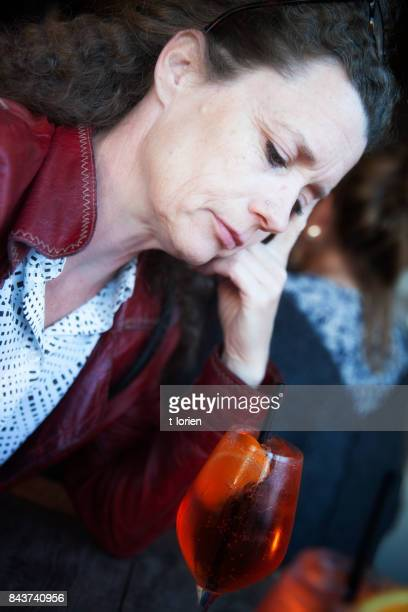 Woman looking at her drink.