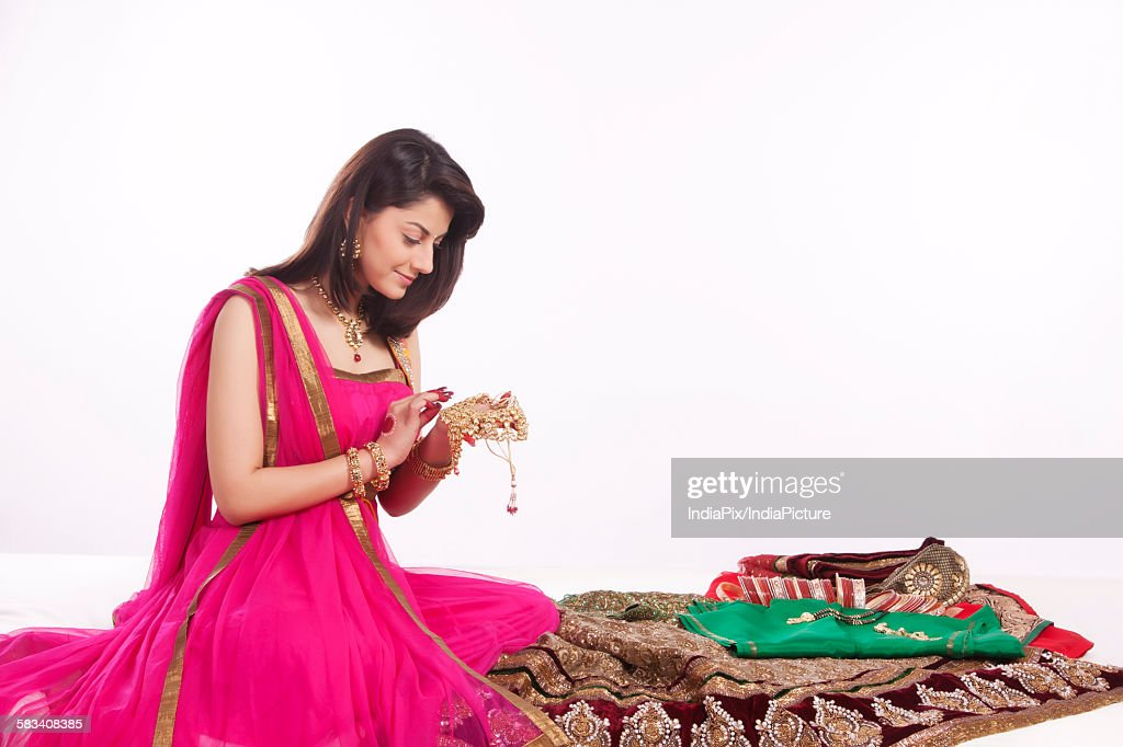 Woman looking at jewelery : Stock Photo