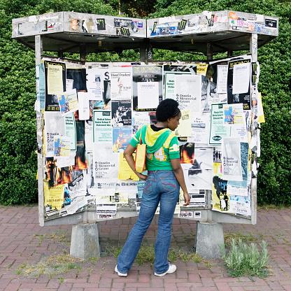 Woman looking at kiosk - gettyimageskorea