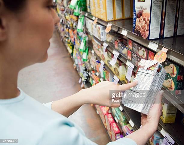Woman Looking at Label at Health Food Store