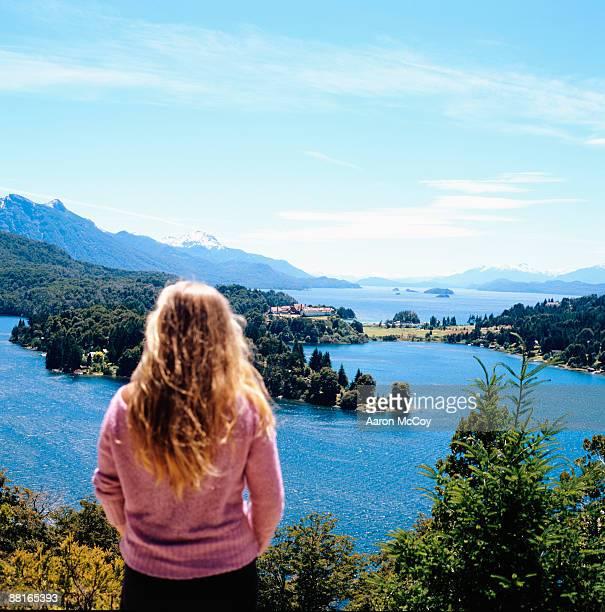 'Woman looking at Lago Nahuel Huapi, Lake District, Patagonia, Rio Negro Province, Argentina'