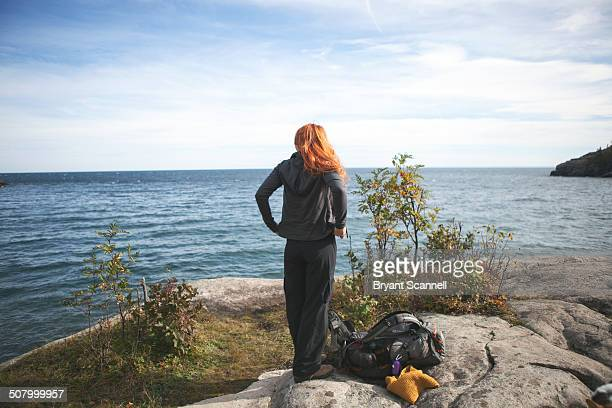 woman looking at lake superior - duluth minnesota stock pictures, royalty-free photos & images