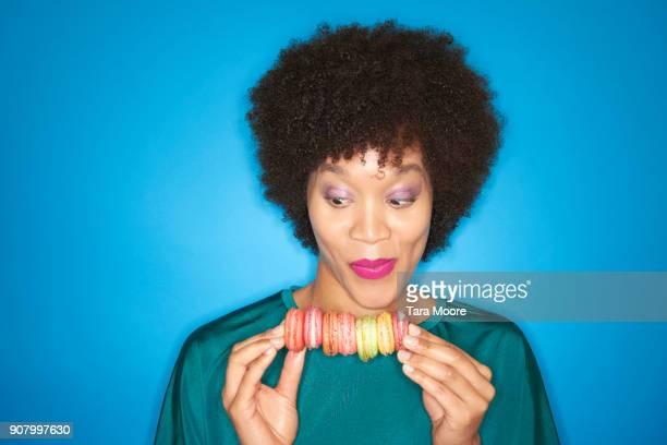 woman looking at macarons
