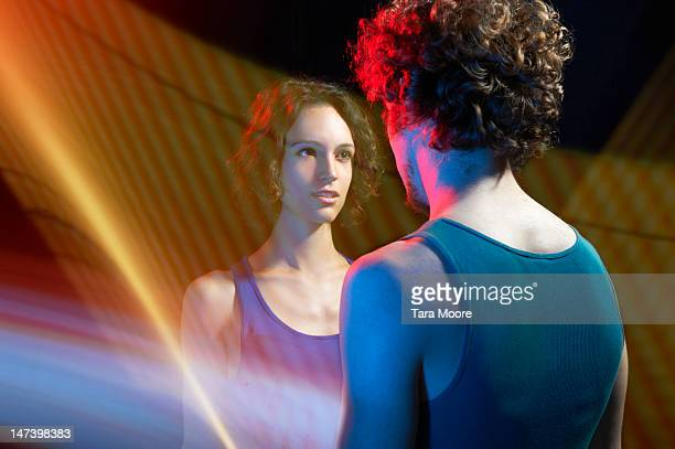 woman looking at man through light trails