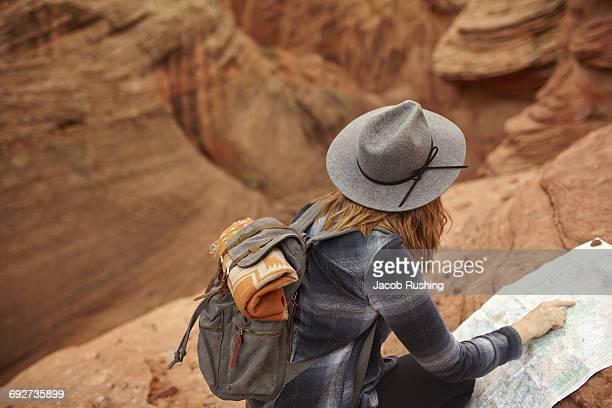 Woman looking at map, rear view, Page, Arizona, USA